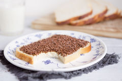 Sandwich with chocolate sprinkles or `hagelslag`. A sandwich with chocolate sprinkles or a `boterham met hagelslag`, Dutch traditional food Stock Photography