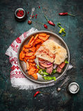 Sandwich with ciabatta bread , roasted meat, vegetables and sweet potato in plate on rustic wooden background Stock Photos