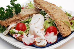 Sandwich close up. Breakfast, fresh home baked full corn bread sandwich with salad, lettuce, chicken fillet and radishes, close up Royalty Free Stock Images
