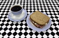 Sandwich with coffee Stock Photos