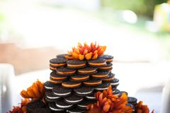 Sandwich Cookie Wedding Cake with Orange Flowers Stock Photography