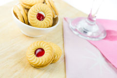 Sandwich cookies with cream and strawberry flavoured jam on whit Stock Photography