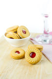 Sandwich cookies with cream and strawberry flavoured jam on whit Royalty Free Stock Photography