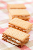 Sandwich cookies on pink tablecloth Royalty Free Stock Image
