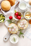 Sandwich with cottage cheese with fresh radish and dill on the white board. Delicious and healthy breakfast Stock Photography