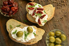 Sandwich with cottage cheese, olives and sun-dried tomatoes Stock Images