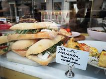 Sandwich on a counter show window in Portobello Market, Notting Hill royalty free stock photography
