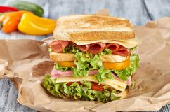 Sandwich,kraft paper sandwich. Sandwich on craft paper, on a wooden background, from different angles, with vegetables royalty free stock photos