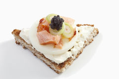 Sandwich with cream cheese, ham and caviar, close-up Stock Photo