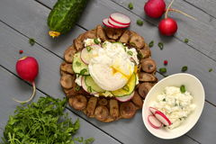 Sandwich with cream cheese, radish, cucumber and poached egg. Top view Royalty Free Stock Photos