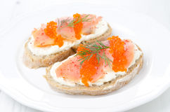 Sandwich with cream cheese, salted salmon and red caviar Royalty Free Stock Images