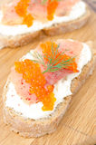 Sandwich with cream cheese, salted salmon and red caviar Royalty Free Stock Image