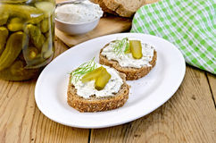 Sandwich with cream and pickles on a board Royalty Free Stock Photos