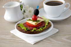 Sandwich with a cup of coffee and milk Royalty Free Stock Photos