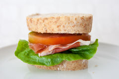 Sandwich of cured ham, tomatoes and lettuce. Sandwich with ham, tomatoes and lettuce, closeup Stock Photography