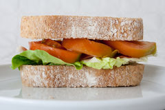 Sandwich of cured ham, tomatoes and lettuce. Sandwich with ham, tomatoes and lettuce, closeup Royalty Free Stock Photography