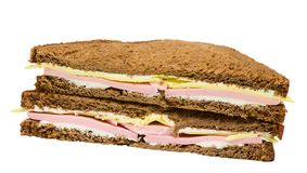 Sandwich of dark bread with cheese and ham. Isolated on white royalty free stock photo