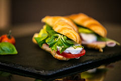Sandwich with delicatessen cheese and fresh leaves salad Stock Photos