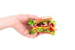 Sandwich in der Hand lokalisiert Stockbild