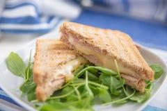 Sandwich des Schinkens und des Schweizer Käses Lizenzfreies Stockbild