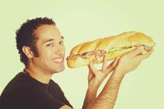 Sandwich die de Mens eten royalty-vrije stock foto's