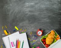Sandwich educational supplies notebook pens colored pencils clips on a chalk board. Concept back to school. Top view stock image