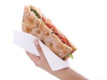 Sandwich in een hand Royalty-vrije Stock Foto's