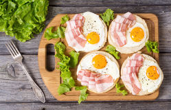 Sandwich with eggs and bacon. On wooden table , top view royalty free stock image