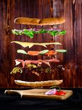 Sandwich with falling ingredients in the air - slices of fresh t royalty free stock images