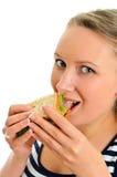 Sandwich femelle à consommation Image stock