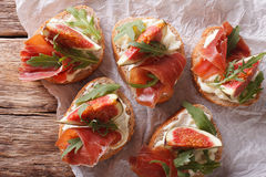Sandwich with figs, ham and cream cheese close-up. Horizontal to Royalty Free Stock Images