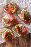 Sandwich with figs, ham and cream cheese close-up. vertical top Stock Images