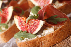 Sandwich with figs, ham and cream cheese macro. horizontal Royalty Free Stock Photo