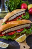 Sandwich with fish. Balik ekmek - turkish fast food Royalty Free Stock Photography