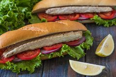 Sandwich with fish. Balik ekmek - turkish fast food.  Royalty Free Stock Photos