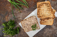 Sandwich with fish pate. Old background. Top view. Close-up Royalty Free Stock Photos