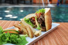 Sandwich food at swimming pool outdoor Royalty Free Stock Photos