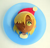 Sandwich in the form of the girl`s head in Santa`s cap. Royalty Free Stock Photography