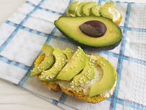Sandwich  freshwith avocado and sesame seeds toast on a wooden. Sandwich fresh avocado and sesame seeds cheese toast   on a wooden Stock Images