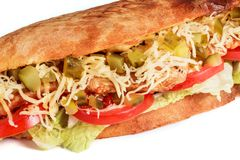 Sandwich from fresh pita bread with fillet grilled chicken, lettuce, slices of fresh tomatoes. Pickles and cheese on white background stock photos