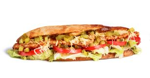 Sandwich from fresh pita bread with fillet grilled chicken, lettuce, slices of fresh tomatoes. Pickles and cheese on white background stock photography
