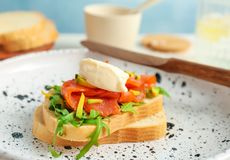 Sandwich with fresh sliced salmon fillet and avocado. On plate, closeup stock images