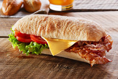 Sandwich with fried bacon cheese tomato Royalty Free Stock Images