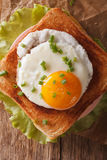 Sandwich with fried egg, ham and cheese close-up on a table vert Royalty Free Stock Images