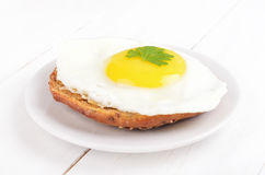 Sandwich with fried egg and parsley Stock Photo