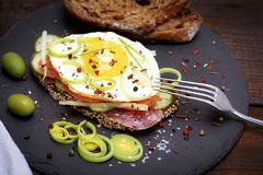 Sandwich with fried egg and a piece of rye bread. With vegetables, close up Royalty Free Stock Photography