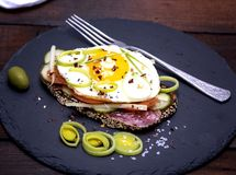 Sandwich with fried egg and a piece of rye bread. With vegetables, close up Stock Images