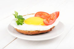 Sandwich with fried egg, tomato slices and parsley Royalty Free Stock Photography