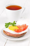 Sandwich with fried egg, tomato slices, salami Stock Photos