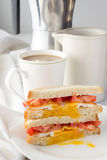 Sandwich with fried egg and tomatoes and cup of coffee Stock Photo